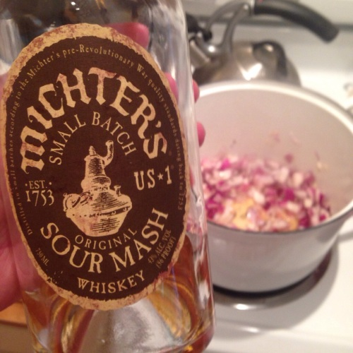 Michter's Small Batch and onions + garlic simmering in the Dutch oven
